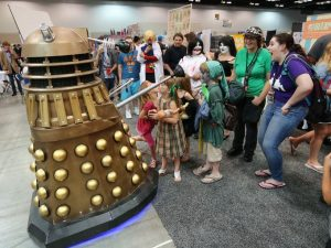 Dalek and crowd on the show floor (er . . . room)!