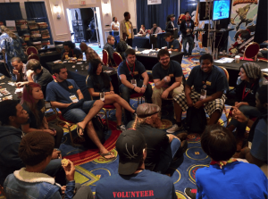 Professionals and students playing a game of Werewolf together in the expo room